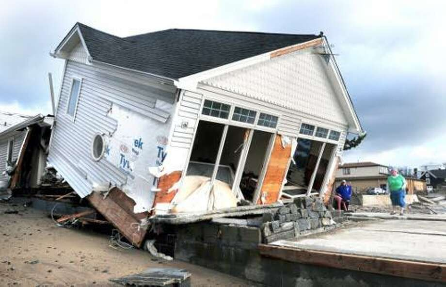 A home along the shorefront on Ann St. in Milford photographed on 10/30/2012 was knocked off its foundation during high tide on the previous night. Photo by Arnold Gold/New Haven Register