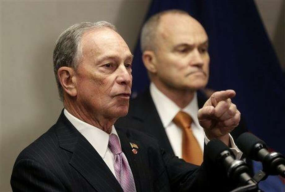 New York City Mayor Michael Bloomberg, left, and Police Commissioner Raymond Kelly speak to the media after a Police Academy graduation ceremony in New York, Friday, Dec. 28, 2012.  The number of New York City murders is expected to hit a record low this year, and shootings are at their lowest point in at least 18 years. (AP Photo/Seth Wenig) Photo: AP / AP