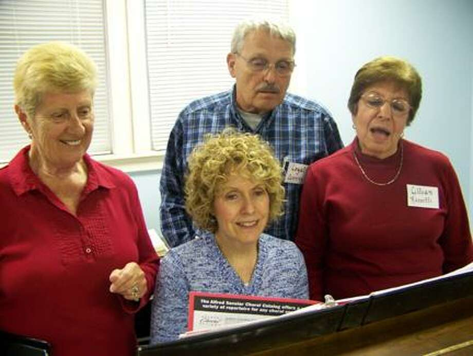 "Submitted PhotoPictured from left are Oneida Area Civic Chorale charter members Sandy Aylesworth, Loyal Canning and Lillian Rossetti as they discuss the upcoming concert with accompanist Bernadette VanValkenburg, who as a high school student accompanied the chorale at their first concert 45 years ago. Missing is Peter Dwyer, who has also been with the chorale since 1967. The chorale will perform ""Give Me Music!"" on Saturday, May 19 at 7:30 p.m. at the First Presbyterian Church of Rome and Sunday, May 20 at 4 p.m. at the Kallet Civic Center, Main Street, Oneida."