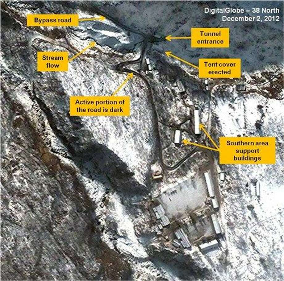 """This satellite image taken Dec. 2, 2012, by DigitalGlobe and annotated and distributed Friday, Dec. 28, 2012 by 38 North, the website of the U.S.-Korea Institute at Johns Hopkins School of Advanced International Studies, shows the traffic flow pattern at the Punggye-ri Nuclear Test Facility in North Korea, where experts suspect Pyongyang will conduct its next detonation. The 38 North Analysis says the road is dark where movement has melted the snow, and the traffic appears limited to the bypass road, the tunnel entrance and the two southern area support buildings. The analysis says the North """"may be able to trigger a detonation in as little as two weeks, once a political decision is made to move forward."""" (AP Photo/DigitalGlobe via 38 North) NO SALES, MANDATORY CREDIT Photo: ASSOCIATED PRESS / AP2012"""
