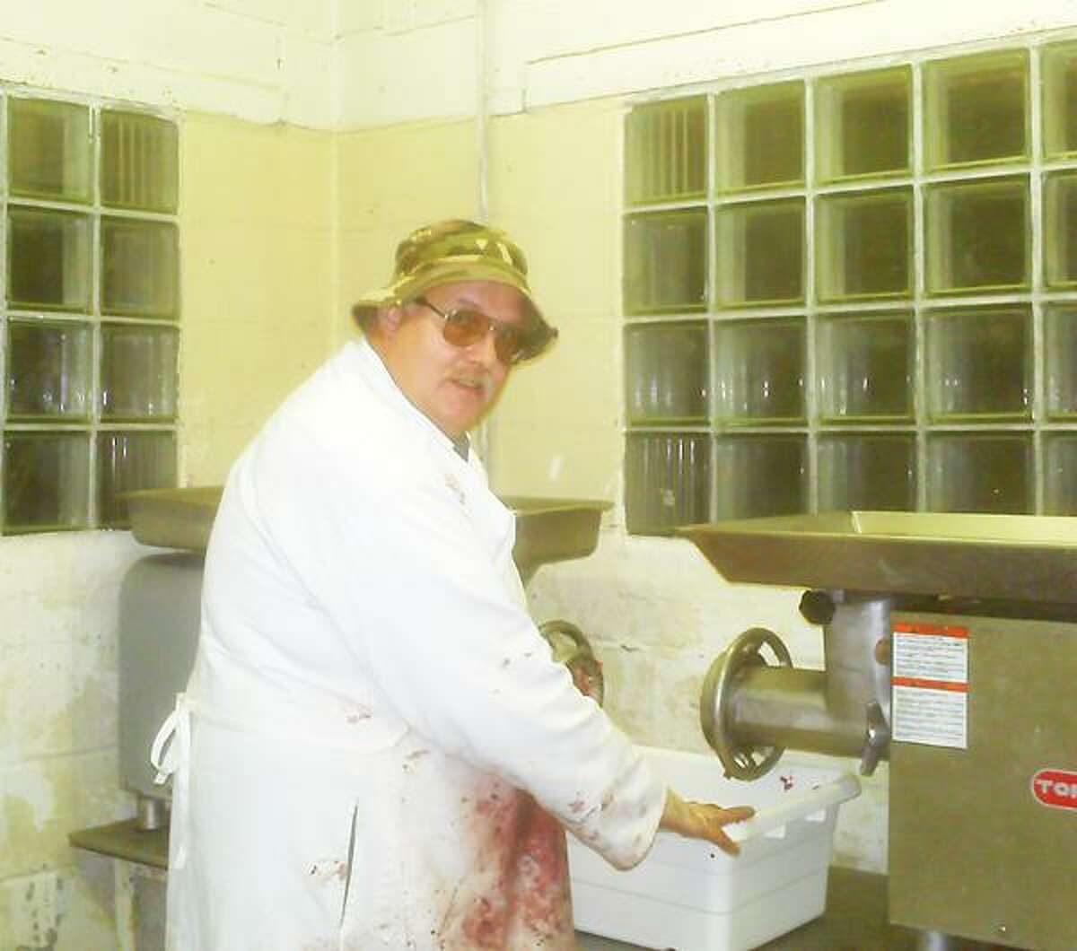 Photo Courtesy CURTIS CUSTOM CUTTING Darrell Curtis, 58, of Verona grinding venison; any meat used for donation through the Venison Donation Coalition has to be ground.