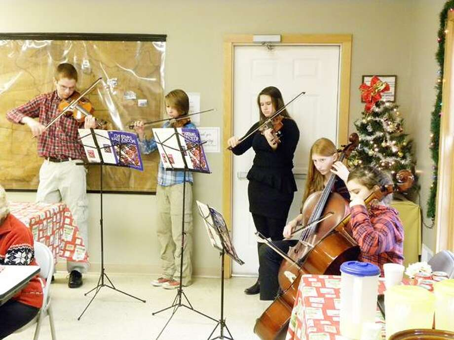 Photo Courtesy CHITTENANGO LANDING CANAL BOAT MUSEUM Musicians from Chittenango High School provide entertainment at the Chittenango Landing Canal Boat Museum's annual volunteer reception Dec. 9