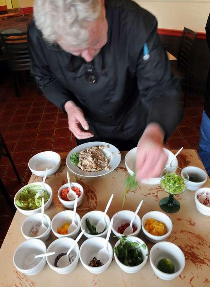 Mara Lavitt/Register photo: Chef Joe Collier of Fresco in West Haven prepares the dish.