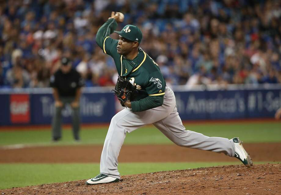 TORONTO, ON - JULY 26: Santiago Casilla #46 of the Oakland Athletics delivers a pitch in the ninth inning during MLB game action against the Toronto Blue Jays at Rogers Centre on July 26, 2017 in Toronto, Canada. (Photo by Tom Szczerbowski/Getty Images) Photo: Tom Szczerbowski, Getty Images