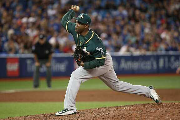 TORONTO, ON - JULY 26: Santiago Casilla #46 of the Oakland Athletics delivers a pitch in the ninth inning during MLB game action against the Toronto Blue Jays at Rogers Centre on July 26, 2017 in Toronto, Canada. (Photo by Tom Szczerbowski/Getty Images)