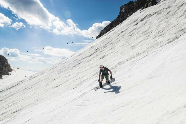 Skiers and snowboarders enjoy summer skiing at Mammoth Mountain on Mon., July 25, 2017.