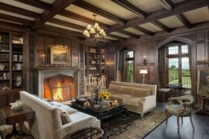 The majestic estate at 945 Sasco Hill Road in Fairfield, Conn. is more than 12,000 square feet and sits on 6.5 acres of impeccably landscaped property. Though built in 2000, the house was constructed to look like an antique, from its leaded glass windows to the hand-hewn beams inside and fireplaces that were constructed to look hundreds of years old.