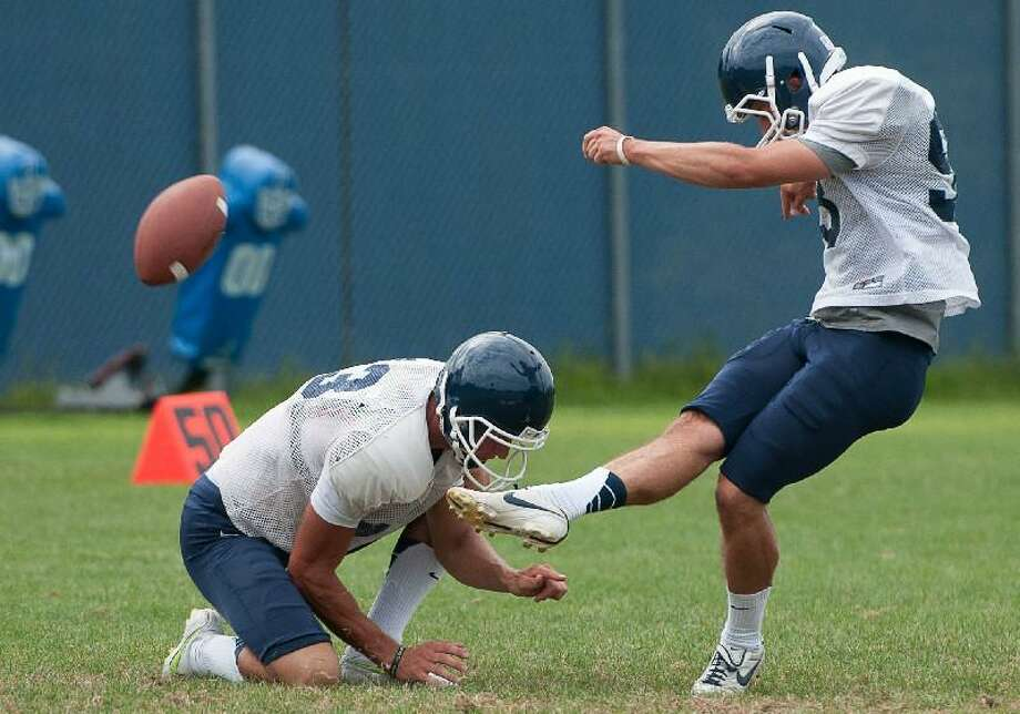 BILL SHETTLE/CAL Sport Media via AP Images Kicker Chad Christen (13) in action during Connecticut's team practice on the campus of the University of Connecticut in Storrs on Aug. 14.