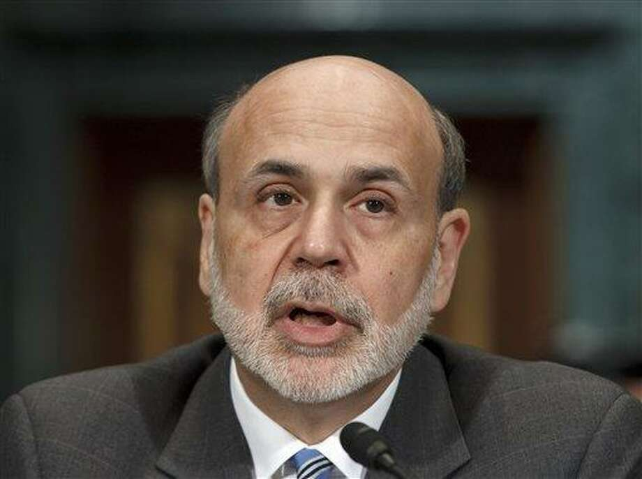 Federal Reserve Board Chairman Ben Bernanke testifies on Capitol Hill in Washington Thursday before the Senate Banking Committee to deliver his twice-a-year monetary report to Congress.   Associated Press Photo: ASSOCIATED PRESS / AP2012