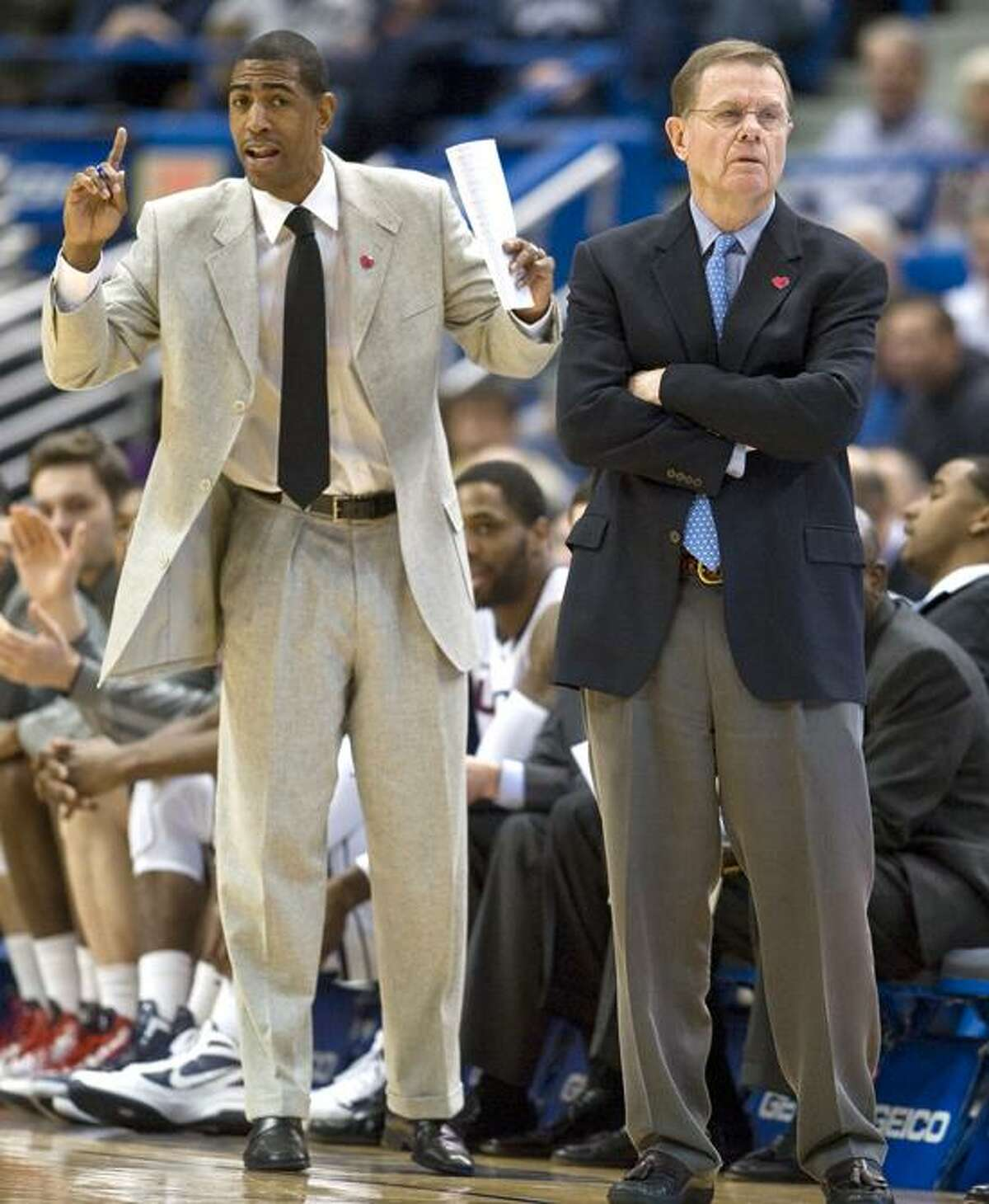 UConn associate head coach George Blaney, right, and assistant coach Kevin Ollie have been watching a once-promising season slip away with 9 losses in the last 12 games. (AP photo)