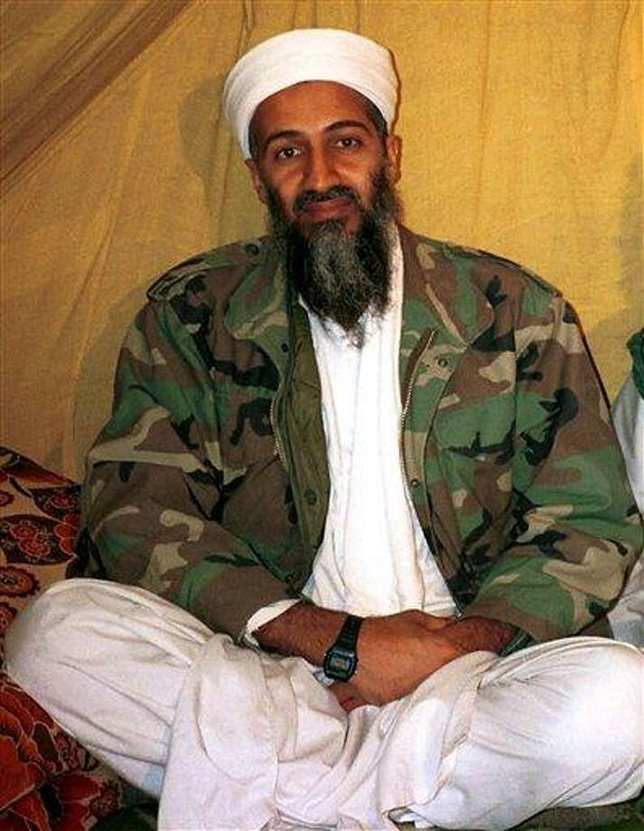 This is an undated file photo shows al Qaida leader Osama bin Laden in Afghanistan. President Barack Obama gave a steely defense of his handling of the raid that killed Osama bin Laden a year ago, and his use of it as a campaign issue now. He is questioning whether rival Mitt Romney would have made the same decision in targeting the al-Qaida leader. Romney says he would.   Associated Press Photo: ASSOCIATED PRESS / AP2012