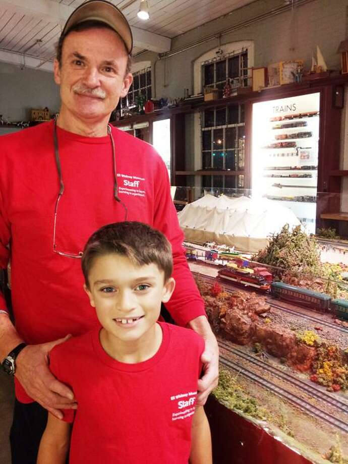 Walter Zawalich of Hamden keeps the Eli Whitney Museum's 50 year old American Flyer trains in tip-top shape. It's a big job, so luckily he has the help of his grandson, Danny Zuwalich, 8, of Cheshire. Sandi Shelton/Register