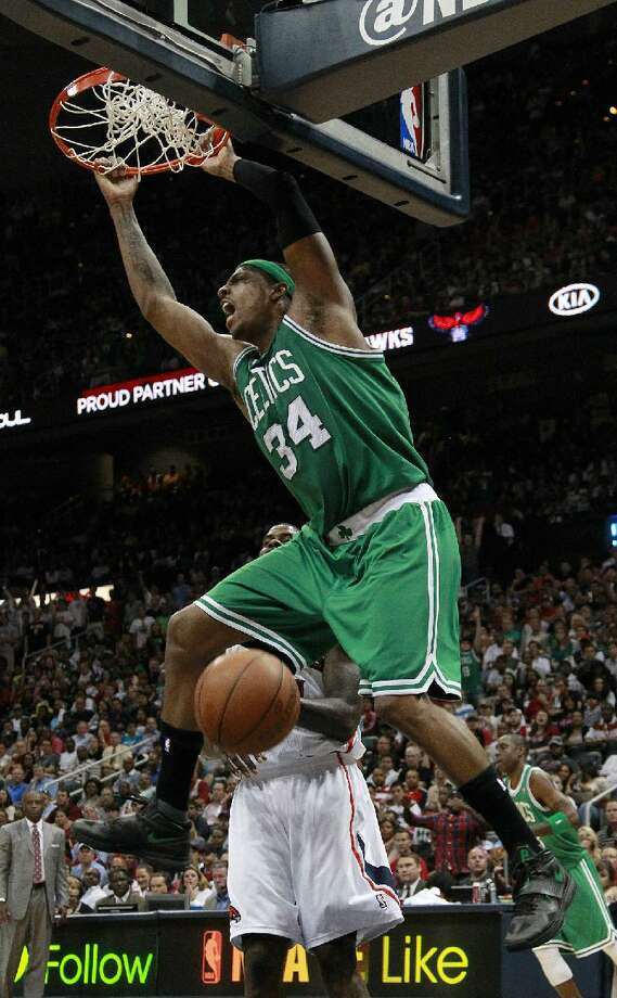 ASSOCIATED PRESS Boston Celtics forward Paul Pierce (34) scores in the second half of Game 2 of an NBA first-round playoff series against the Atlanta Hawks on Tuesday in Atlanta. Boston won 87-80 and evened the series at one game each.