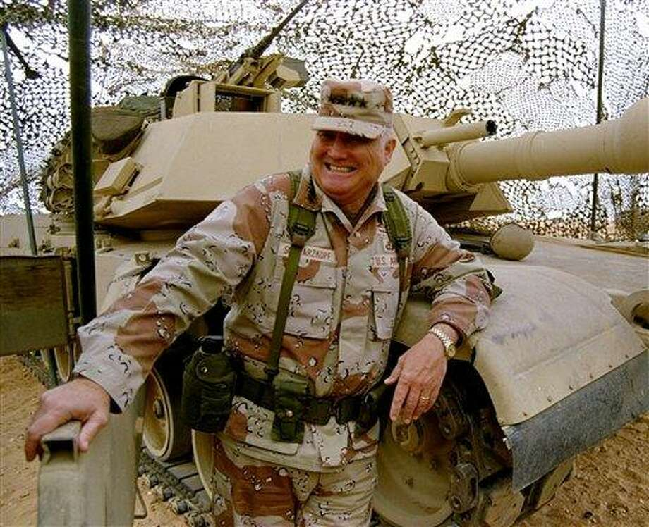FILE - In this Jan. 12, 1991 file photo, Gen. H. Norman Schwarzkopf stands at ease with his tank troops during Operation Desert Storm in Saudi Arabia. Schwarzkopf died Thursday, Dec. 27, 2012 in Tampa, Fla. He was 78.  (AP Photo/Bob Daugherty, File) Photo: AP / AP