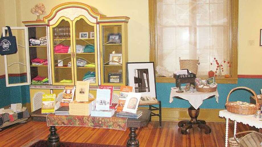 Photo Courtesy ONEIDA COMMUNITY MANSION HOUSE The Oneida Community Mansion House has expanded its store with more books, trinkets and local crafts, including candles by The Bee Man Candle Co. in Canastota.