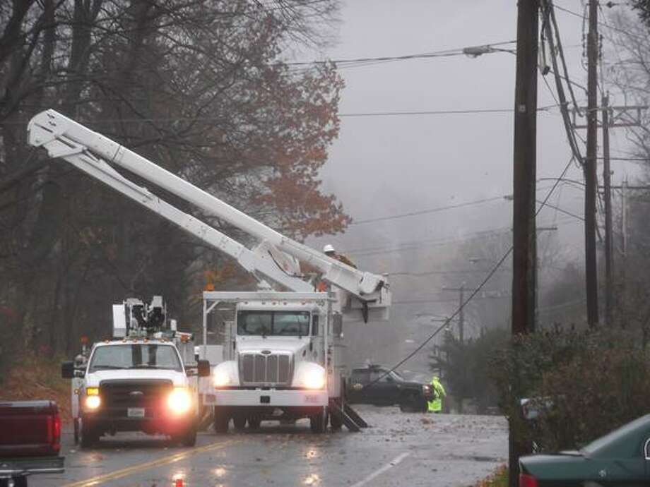 Utility crews repair a damaged power line on Highland Avenue in Torrington Monday. (Ricky Campbell photo)