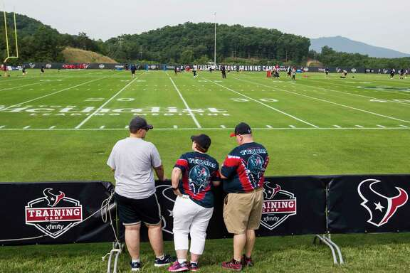 Houston Texans fans look on as players come onto the field during training camp at the Greenbrier on Thursday, July 27, 2017, in White Sulphur Springs, W.Va.
