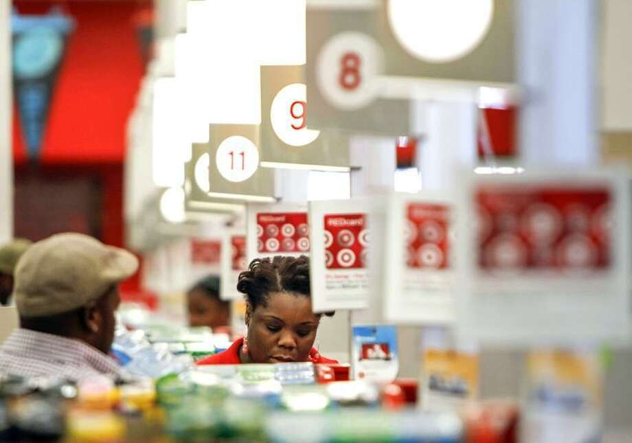 In this Wednesday, Aug. 22, 2012, photo, a cashier rings up a sale at a Target store in Chicago. A private research group says that consumer confidence unexpectedly fell in August to the lowest level since November 2011, as Americans' outlook about jobs flared up. The New York-based Conference Board said Tuesday, Aug. 28, 2012, that its Consumer Confidence Index fell to 60.6, down from a revised 65.4 in July. Economists had expected a reading of 66. The index now stands at the lowest point since November 2011 when the reading was at 55.2.  Associated Press Photo: AP / AP2012