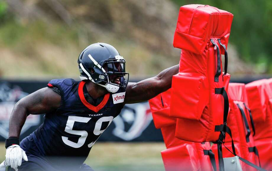 Houston Texans outside linebacker Whitney Mercilus (59) hits a blocking sled during training camp at the Greenbrier on Thursday, July 27, 2017, in White Sulphur Springs, W.Va. Photo: Brett Coomer, Houston Chronicle / © 2017 Houston Chronicle}