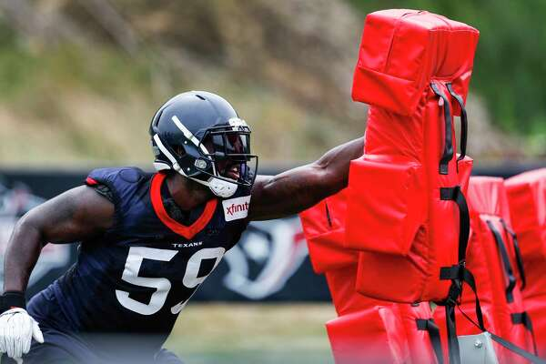 Houston Texans outside linebacker Whitney Mercilus (59) hits a blocking sled during training camp at the Greenbrier on Thursday, July 27, 2017, in White Sulphur Springs, W.Va.