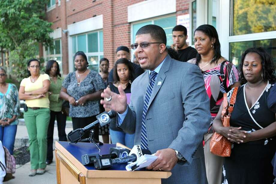 "Hillhouse High School Principal Kermit Carolina talks during a press conference answering allegations of preferential academic treatment for athletes. Carolina responded that the mayor's allegations are ""political.""  Peter Casolino/New Haven Register"