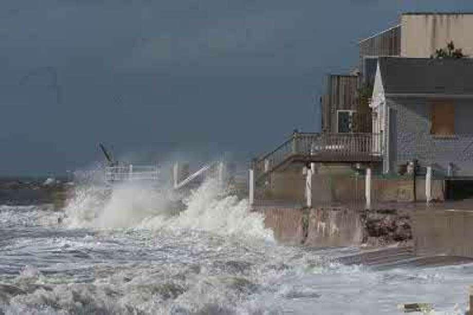 Waves slamming homes in East Haven