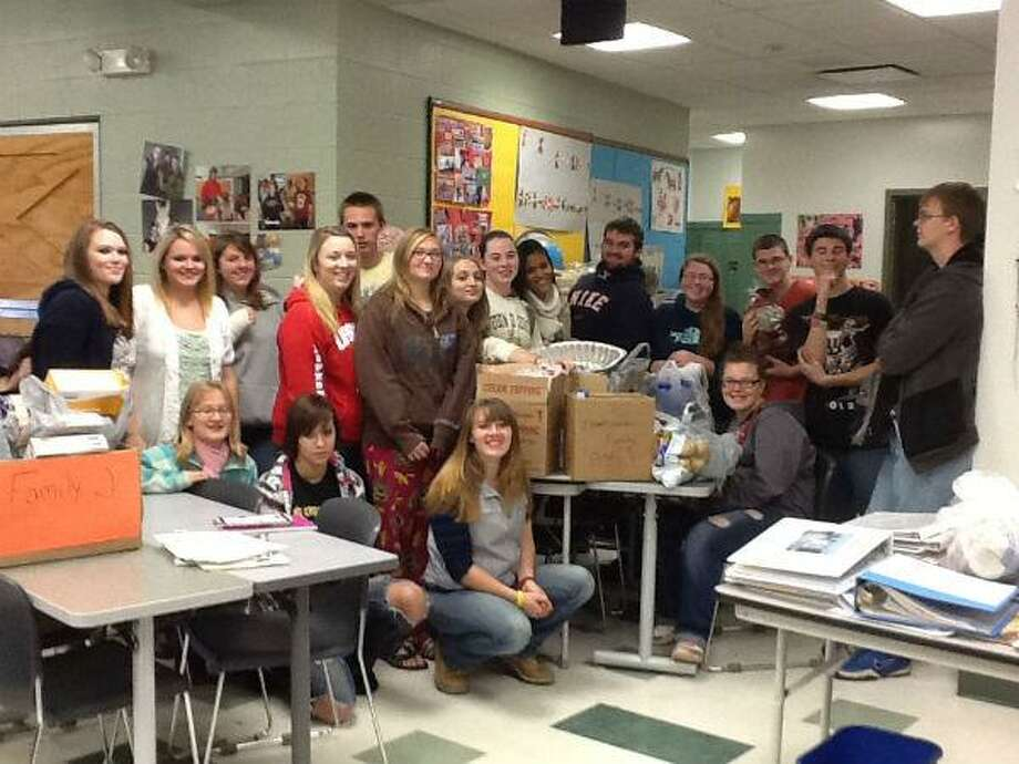 Photo Courtesy MADISON-ONEIDA BOCES Staff and students at Madison-Oneida BOCES helped support 25 area families during the holidays.