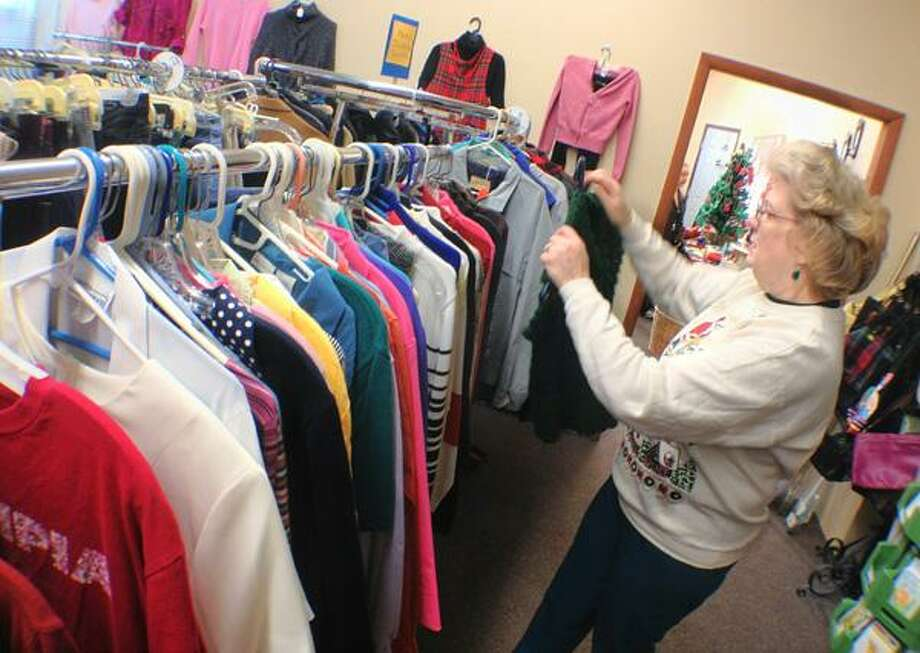 """Dispatch Staff Photo by JOHN HAEGER <a href=""""http://twitter.com/oneidaphoto"""">twitter.com/oneidaphoto</a> Opportunity Shop volunteer Dianne Sgroi works to restock a clothing rack on Thursday, Oct. 19, 2012 in Canastota."""