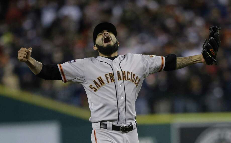 San Francisco Giants' Sergio Romo reacts after striking out Detroit Tigers' Miguel Cabrera in the 10th inning of Game 4 of baseball's World Series Sunday, Oct. 28, 2012, in Detroit. The Giants won the game 4-3 to win the World Series. (AP Photo/Matt Slocum) Photo: ASSOCIATED PRESS / AP2012
