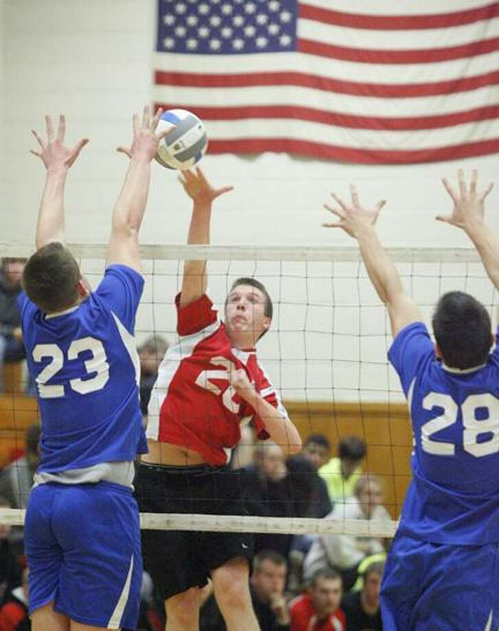 Dispatch Staff Photo by JOHN HAEGER (Twitter: @OneidaPhoto) VVS' Jacob Bitz (20) puts a shot over the net during last year's Section III Class B final. Bitz and the Red Devils are looking for their third straight Section III title this season.