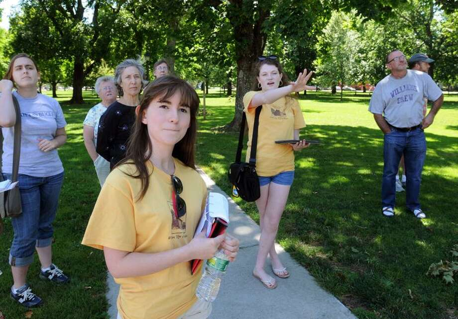 The GUilford Preservation Alliance has begun tours of historic Guilford led by Guilford High School students. One tour set out with Megan Vanacore left and Elya Bottiger right in yellow t-shirts. Mara Lavitt/New Haven Register6/26/12