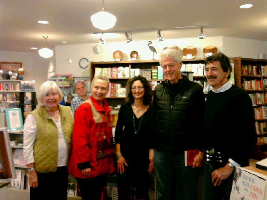"""SUBMITTED PHOTO Left to right: bookstore owner Fran Kielty, Hillary Clinton, Florence Friedmann Minor, Bill Clinton, Gordon Titcomb. Signing was for Titcomb and Minor's new book """"The Last Train."""""""