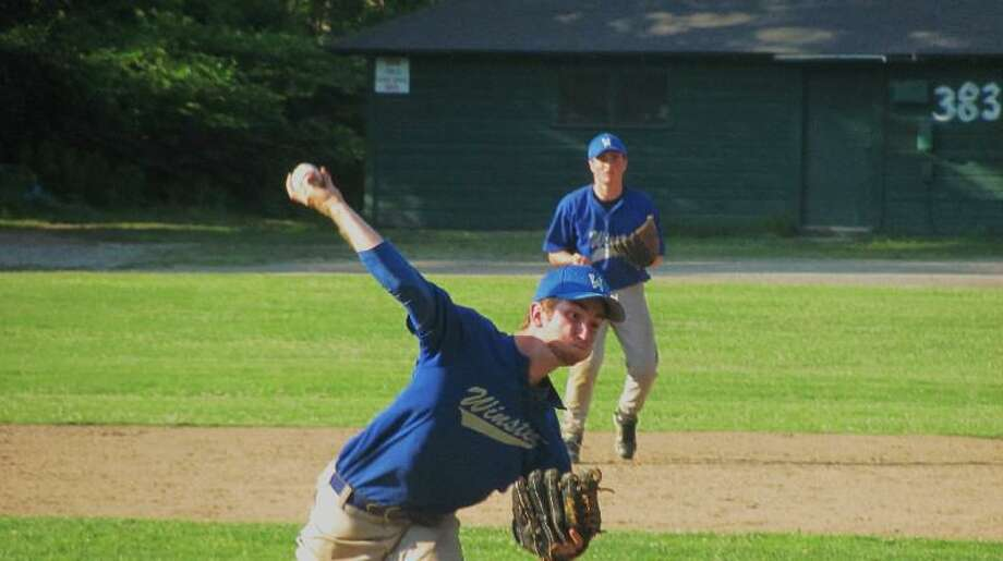 JOHN NESTOR/Register Citizen Correspondent Winsted's Robert Weiss delivers a pitch during Friday evening's Connie Mack game against Torrington Sports Palace at Walker Field. Winsted won 3-0. Winsted's second baseman is Eddie Eseppi.