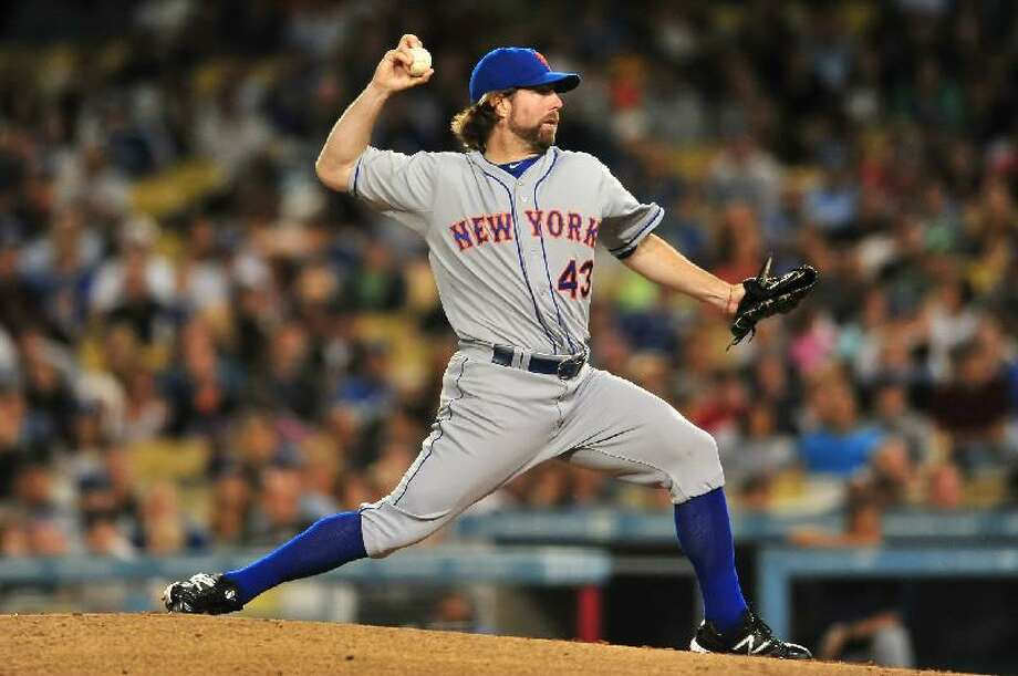 ASSOCIATED PRESS New York Mets pitcher R.A. Dickey delivers during Friday night's game against the Los Angeles Dodgers at Dodger Stadium in Los Angeles. The Mets won 9-0.