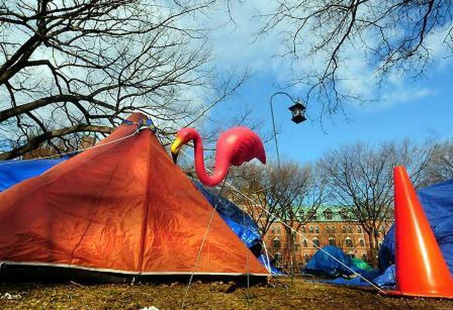 Occupy New Haven folks customize their living space with herb gardens, lawn flamingoes, political statements, and a bit of the Irish. Melanie Stengel/Register