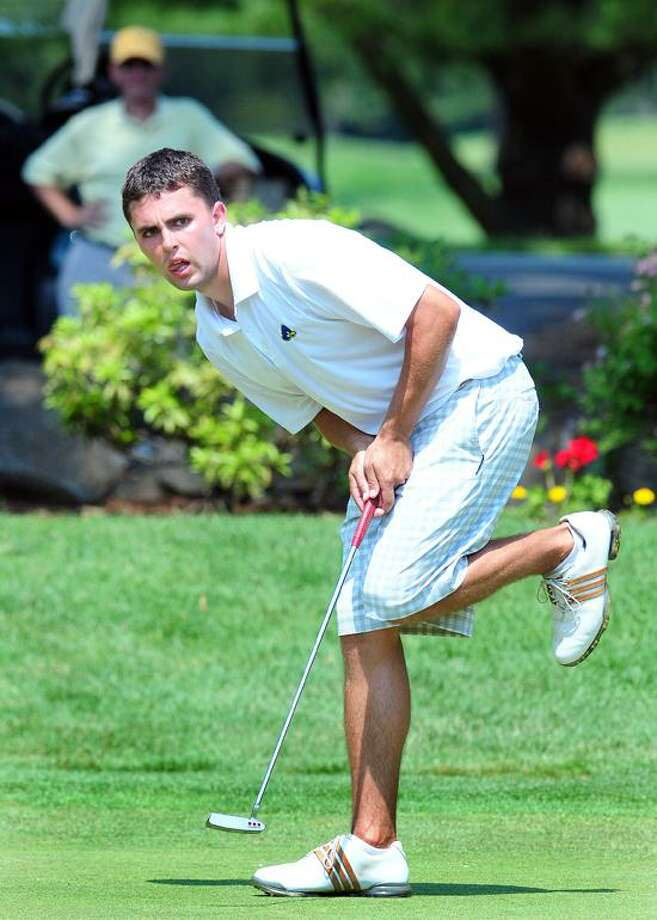 Ben Conroy watches his putt on the final hole of the CSGA Final at Race Brook Country Club in Orange on 6/29/2012.Photo by Arnold Gold/New Haven Register  AG0454E
