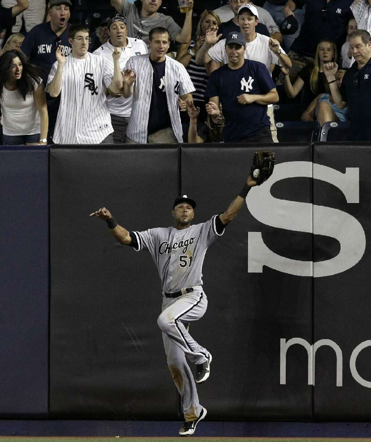 ASSOCIATED PRESS Chicago White Sox right fielder Alex Rios, bottom, catches New York Yankees Derek Jeter's ninth-inning fly-out with a man on first for the final out in the White Sox's 4-3 victory on Thursday at Yankee Stadium in New York.
