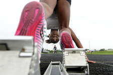 Jayla Franklin gets into position to practice taking off from the blocks as members of the Beaumont Track Club practice at Ozen High School Monday. The club, which is in its 30th year, is once again sending scores of its runners, who range in age from 6 to 18, to a state meet in McAllen this Saturday. Like many club members, Jayla is a multi-generation of family who have participated in the club. Her father Jeff Franklin, who is now a relay team coach, ran for the club as a youth. Photo taken Monday, July, 24, 2017 Kim Brent/The Enterprise