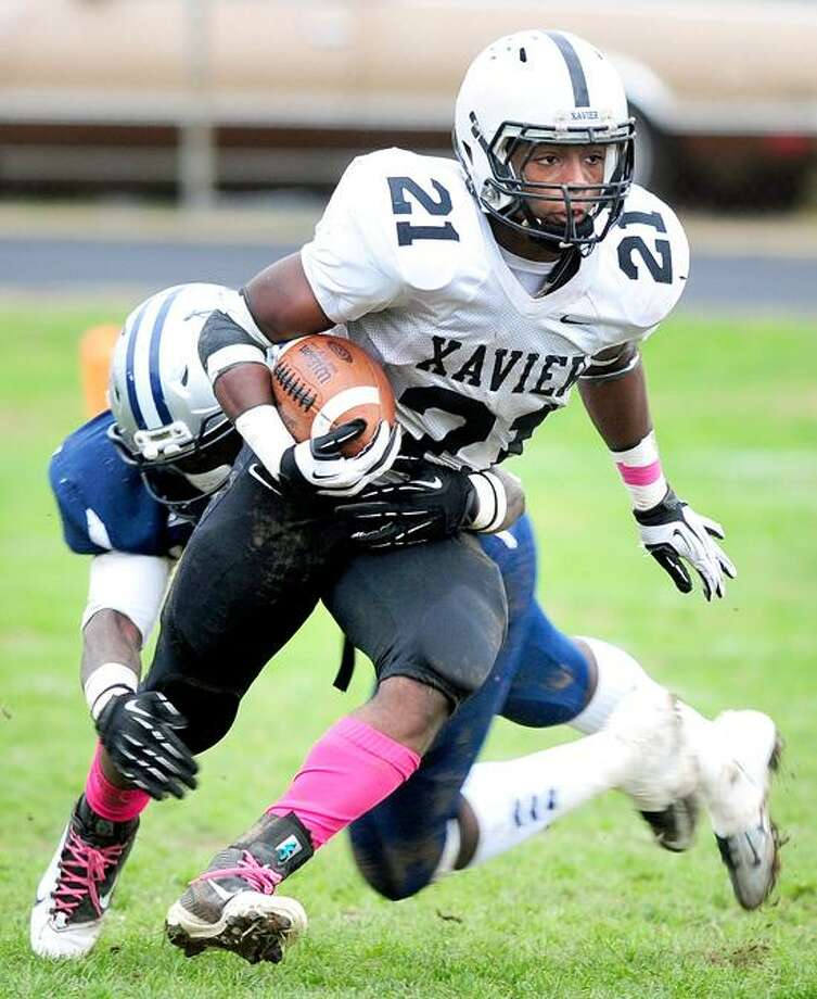 DeAngelo Berry of Xavier rushed 17 times for 90 yards and three touchdowns, including the game-winner with 21 seconds left. His 2-point conversion run helped Xavier win 50-49 over Hillhouse. Photo by Arnold Gold/New Haven Register