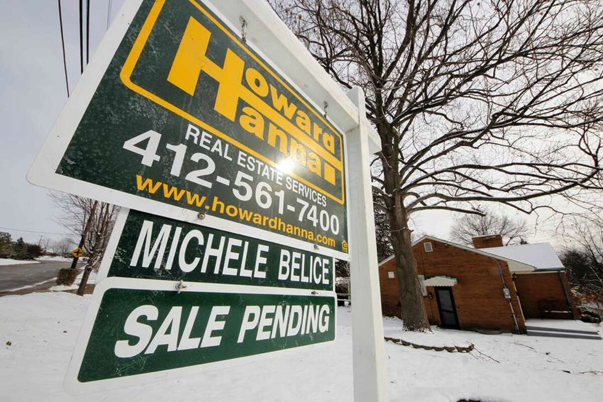 This Jan. 20, 2012, photo shows a home with a sale pending sign in Mount Lebanon, Pa. The number of Americans who signed contracts to buy homes rose in January to the highest level in nearly two years, supporting the view that the housing market is gradually coming back. Associated Press