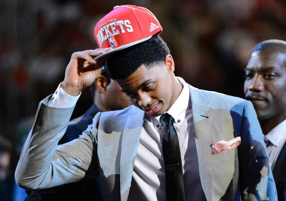June 28, 2012; Newark, NJ, USA; Jeremy Lamb (Connecticut) puts on a cap after being introduced as the number twelve overall pick to the Houston Rockets during the 2012 NBA Draft at the Prudential Center.  Mandatory Credit: Jerry Lai-US PRESSWIRE Photo: US PRESSWIRE / Jerry Lai