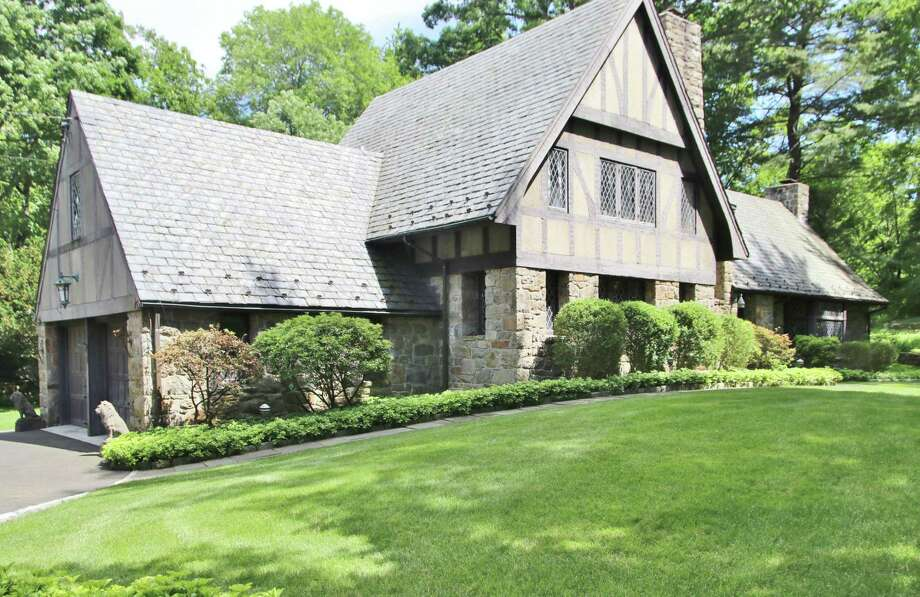 The English Tudor house at 58 Andrews Drive in the Tokeneke neighborhood comprises stone, stucco and half timbering on its exterior façade. Photo: Contributed Photos