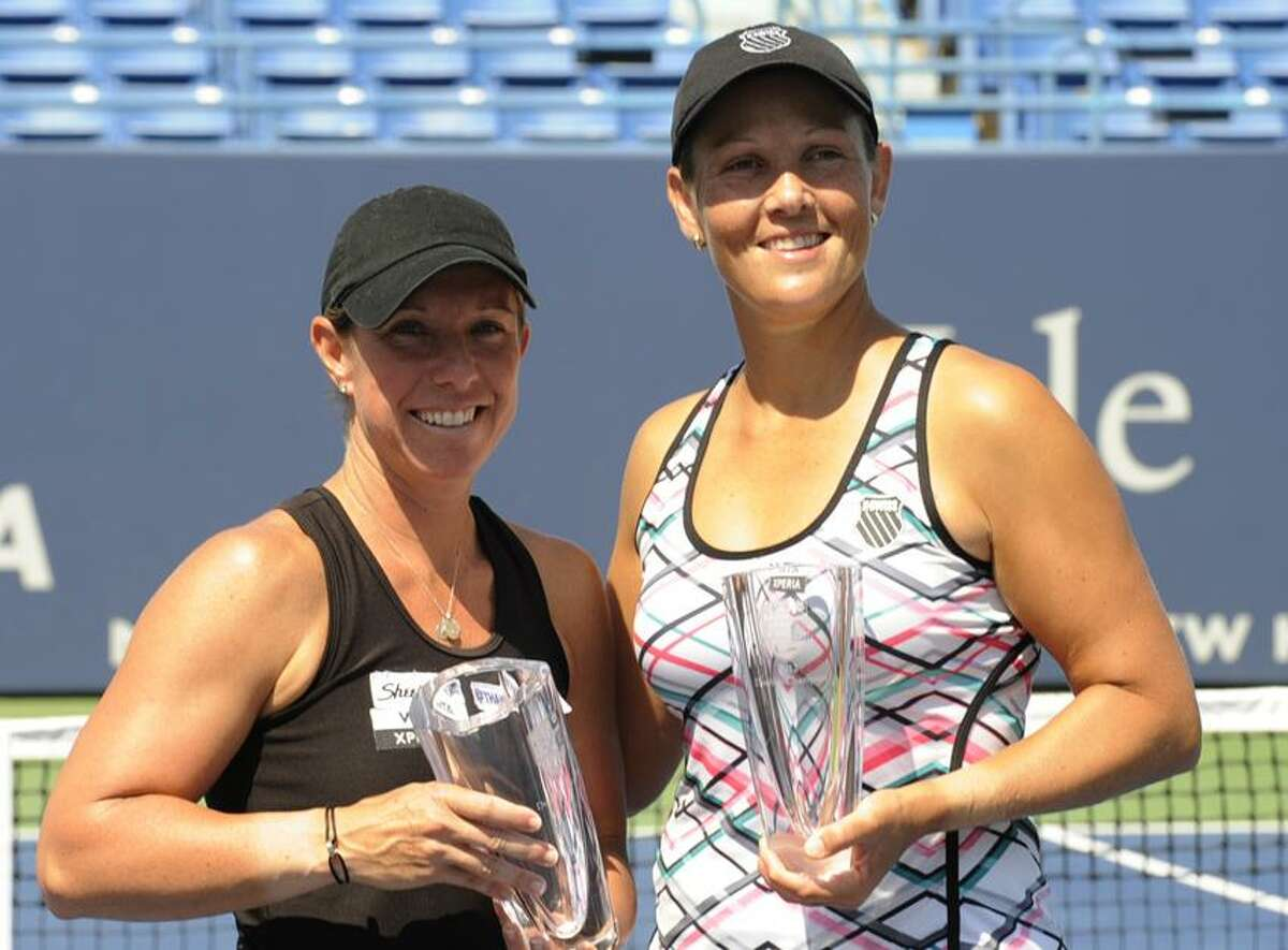 Lisa Raymond, left, and Liezel Huber won the New Haven Open doubles championship on Saturday at the Connecticut Tennis Center at Yale. (Bob Child/Special to the Register)