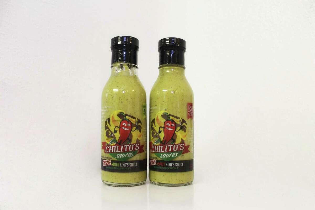 Chilito's Sauces, Boerne: Al Maldonado and Deets Finley Sr. bottle the popular Kika Sauce made at Chilito's Express. ChilitosExpress.com