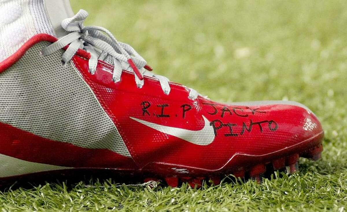 """The shoe of New York Giants wide receiver Victor Cruz bears the words """"R.I.P. Jack Pinto"""" in memory of one of the children killed in the Sandy Hook Elementary School shootings in Newtown, Connecticut, during first half NFL play against the Atlanta Falcons, in Atlanta, Georgia, December 16, 2012. REUTERS/Tami Chappell"""