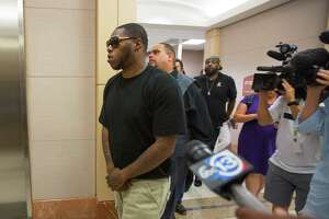"""Houston rapper Joseph Wayne McVey, commonly known by """"Z-Ro,"""" leaves the 351st courtroom of the Harris County Courthouse Thursday, July 27 2017, in Houston. McVey is accused of beating his now ex-girlfriend Brittany Bullock, also known by her rapper stage name """"Just Brittany,"""" while brandishing a handgun in his Katy area home in April."""