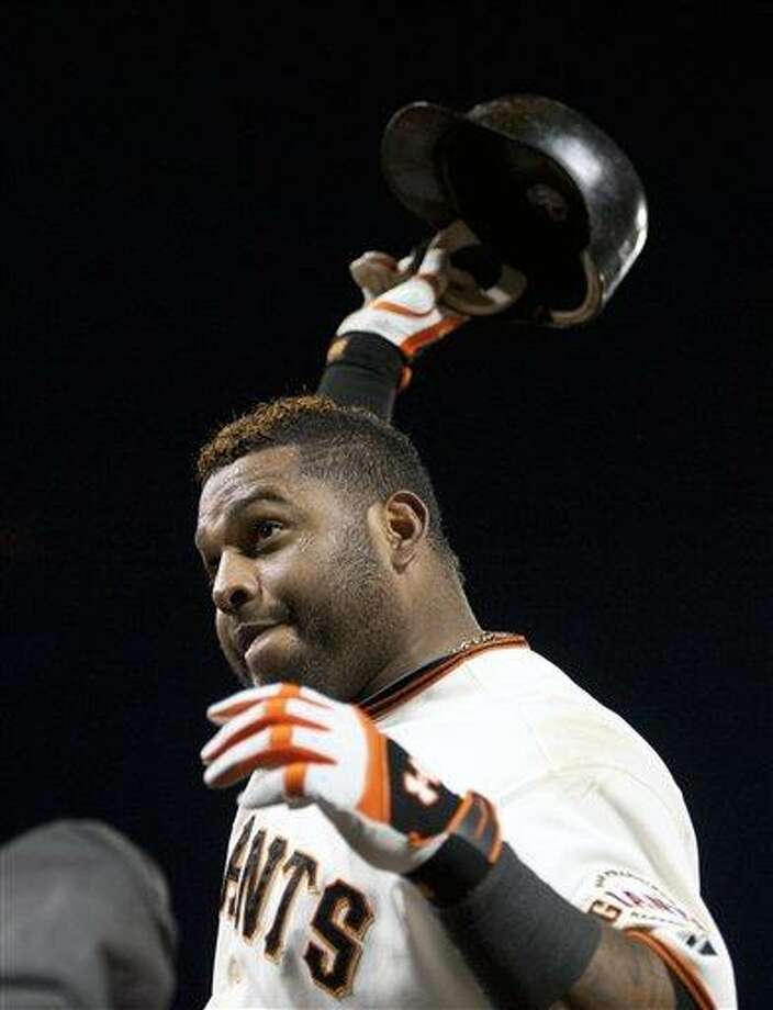 San Francisco Giants' Pablo Sandoval tips his helmet to the crowd after hitting his third home run against the Detroit Tigers during Game 1 of baseball's World Series, Wednesday, Oct. 24, 2012, in San Francisco. (AP Photo/The Sacramento Bee, Paul Kitagaki Jr.) MAGS OUT; TV OUT (KCRA3, KXTV10, KOVR13, KUVS19, KMAZ31, KTXL40) MANDATORY CREDIT Photo: AP / The Sacramento Bee