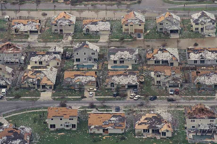 Rows of damaged houses between Homestead and Florida City, Fla. sit in the aftermath of the worst hurricane to hit the South Florida area in 60 years, Aug. 25, 1992.  Hurricane Andrew stormed ashore shortly before sun-up Monday morning with winds measured at 168 mph.  (AP Photo/Mark Foley) Photo: ASSOCIATED PRESS / AP1992
