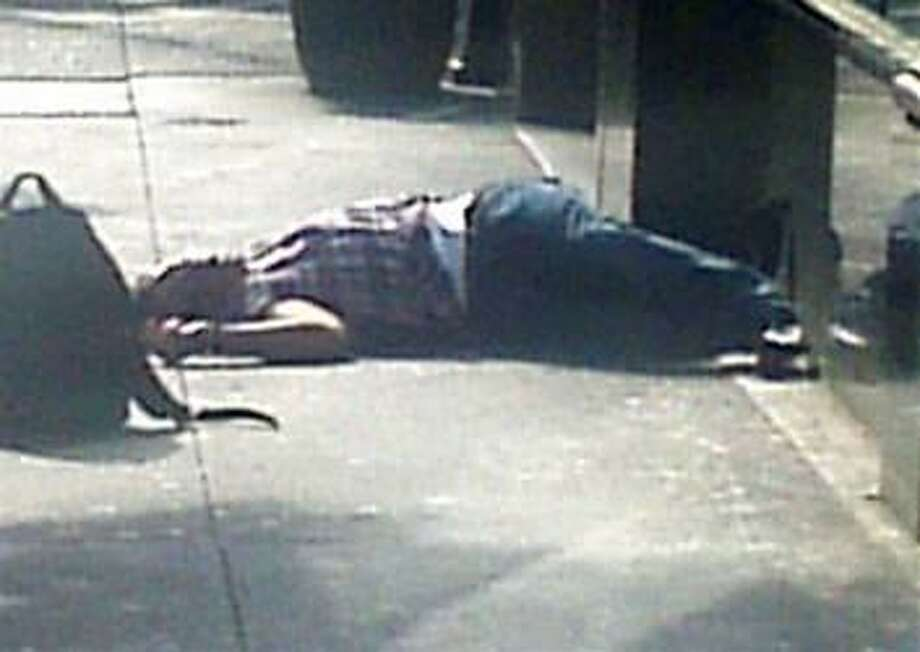 The body of a man lies on the sidewalk near the Empire State Building following a shooting in New York Friday. Two people were killed and at least eight wounded in the shooting outside the landmark building in New York City, according to a New York police source. (REUTERS/James Bolden)