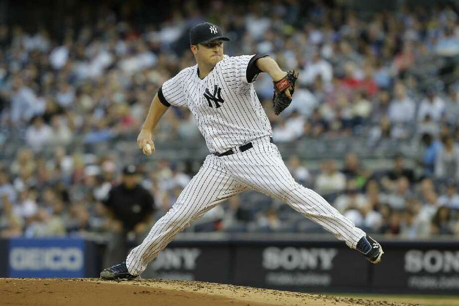 ASSOCIATED PRESS New York Yankees starting pitcher Phil Hughes delivers against the Cleveland Indians during Tuesday's game at Yankee Stadium in New York. The Yankees won 6-4.